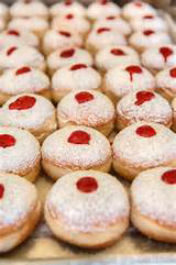 Trays of sufganiyot are common sights in Israeli bakeries during Chanukah